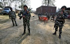 Central Reserve Police Force (CRPF) personnel stand guard at a temporary camp ahead of the publication of the first draft of the National Register of Citizens (NRC) in the Juria village of Nagaon district in the northeastern state of Assam, India, Dec 28, 2017. Reuters