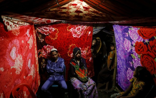 Rohingya refugees Saddam Hussein, 23, and Shofika Begum, 18, pose for a picture in a tent decorated with blankets just after getting married at the Kutupalong refugee camp near Cox's Bazar, Bangladesh, December 11, 2017. Reuters