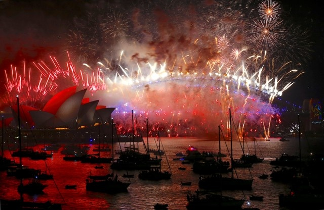 Fireworks light up the Sydney Harbour Bridge and Sydney Opera House during new year celebrations on Sydney Harbour, Australia, January 1, 2018. REUTERS