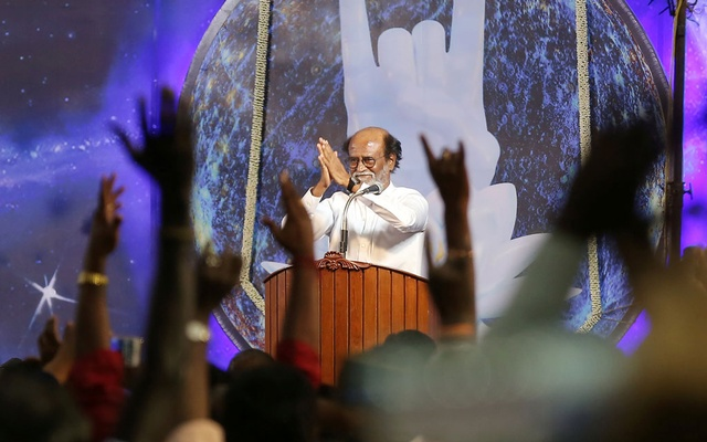Actor Rajinikanth greets his supporters after announcing the launch of his political party in Chennai, India, Dec 31, 2017. Reuters