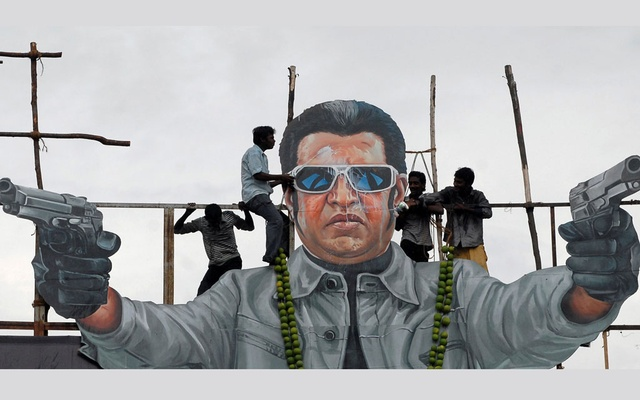This 2010 photo shows Rajinikanth fans pouring milk as an offering over his cut-out on the release date of a new movie starred by him, Chennai, India. Reuters