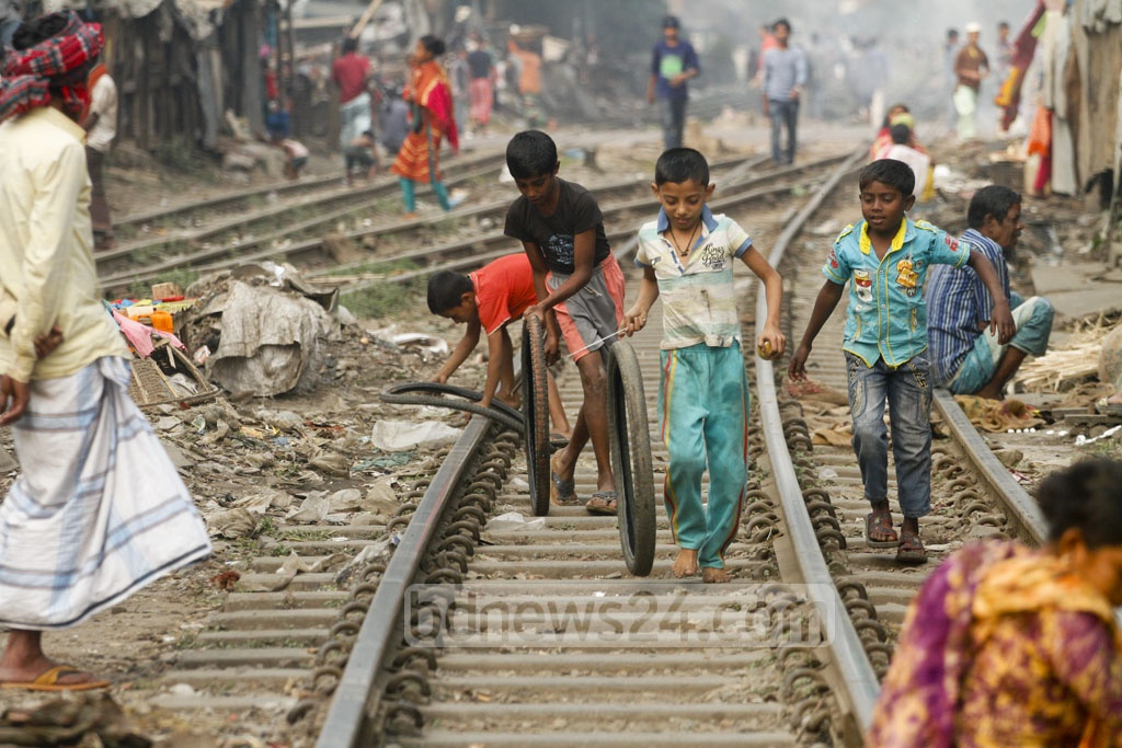 Kids from the slums sprouted along the railway line in Karwan Bazar play on the track despite the risk of being hit by a running train. The photo is taken on Tuesday. Photo: asif mahmud ove