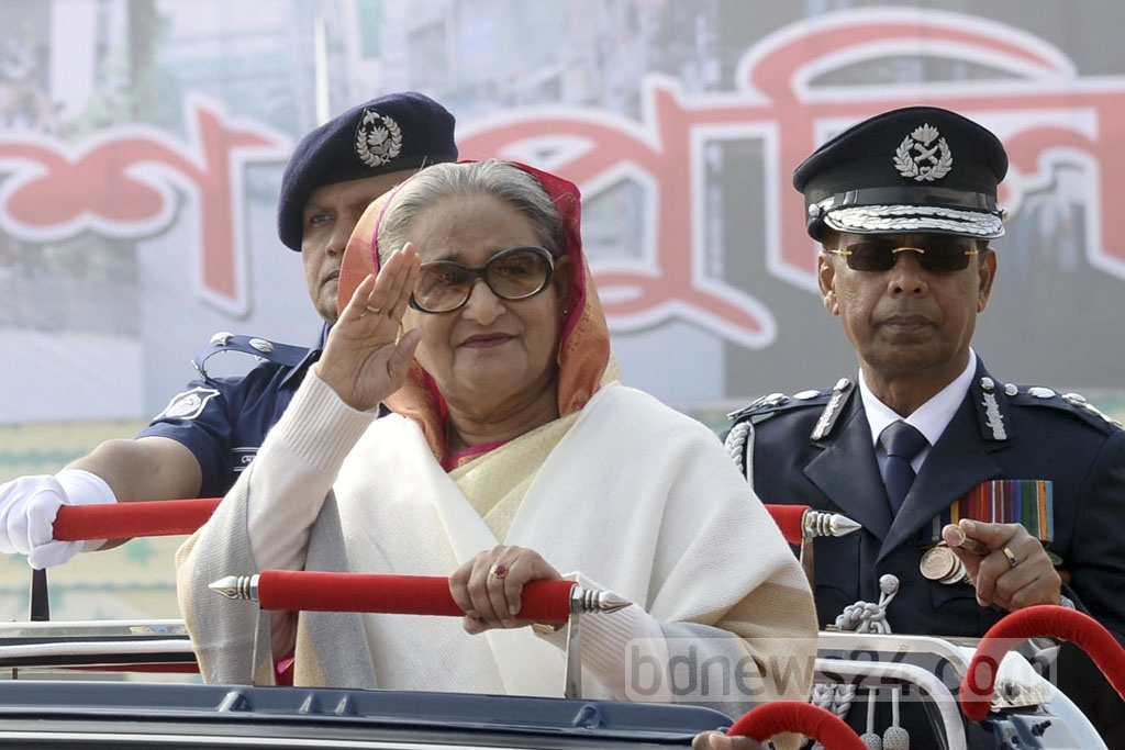 Prime Minister Sheikh Hasina inspects a parade and receives salutes at the National Police Week event in Dhaka on Monday.