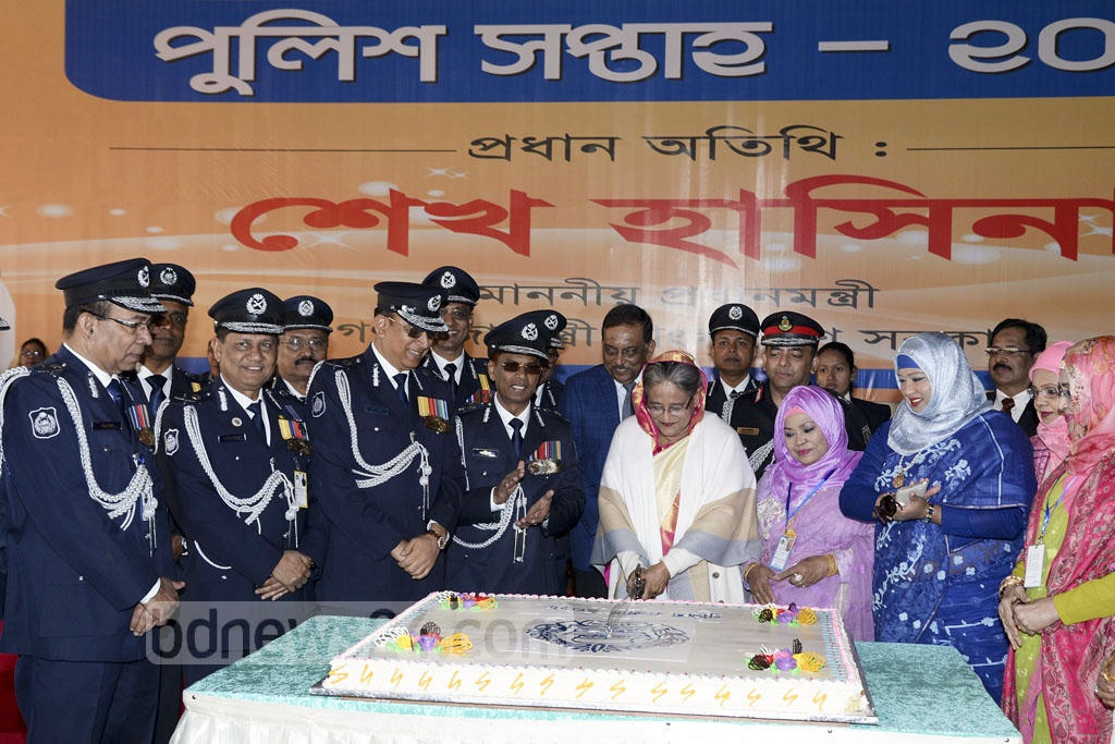 Prime Minister Sheikh Hasina cuts a cake at the inauguration of the National Police Week in Dhaka on Monday.