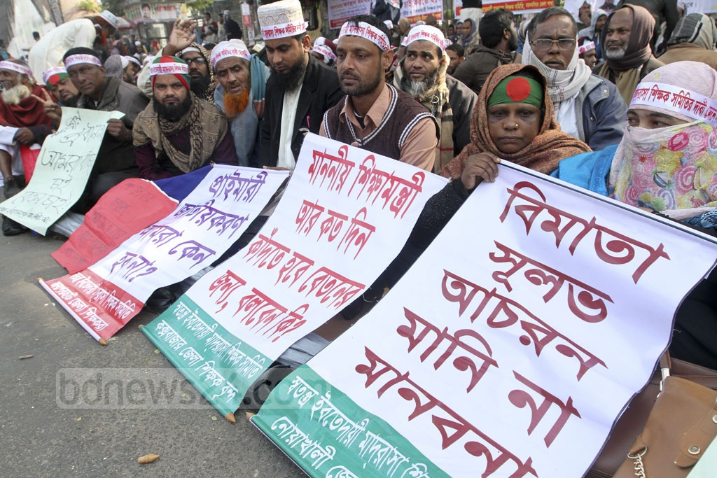Teachers of Ebtedayee madrasas, registered with the Madrasa board, are on a sit-in protest for the last eight days in Dhaka demanding their institutions to be nationalised. Photo taken on Monday in front of the National Press Club in the capital. Photo: dipu malakar