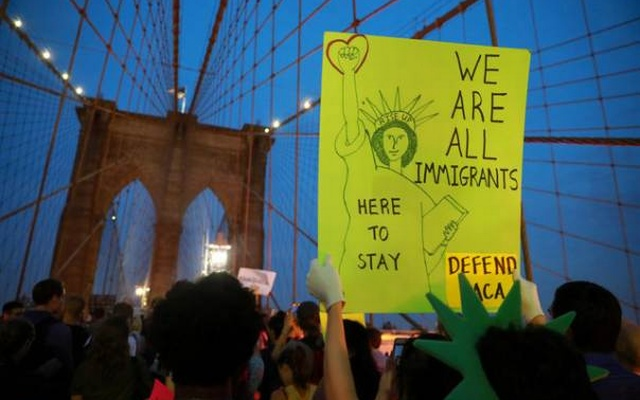 People march across the Brooklyn Bridge to protest the planned dissolution of DACA in Manhattan New York City US
