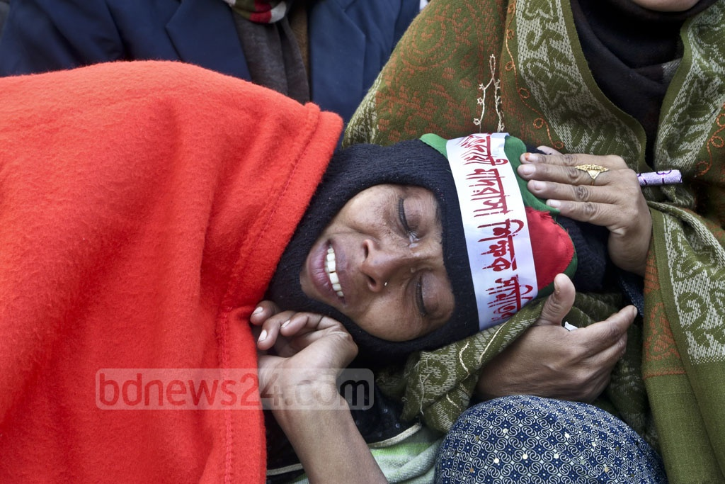 An Ebtedayee madrasa teacher starts crying as she begins the hunger strike with her colleagues in front of the National Press Club in the capital on Tuesday. They have been staying there on a sit-in protest since Jan 1 demanding nationalisation of their educational institutions across the country.