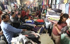 As the cold wave sweeps the country with record low temperature, the demand for winter clothes grew all over the country. The picture is taken from the Sadarghat wholesale market for second-hand clothes at the old part of the capital on Tuesday.