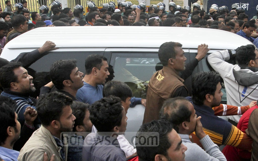 BNP activists bring out an instantaneous procession surrounding their party chief's vehicle as she came out of the special court in Bakshibazar where she attended the proceedings of Zia Orphanage Trust graft case on Wednesday. Photo: dipu malakar