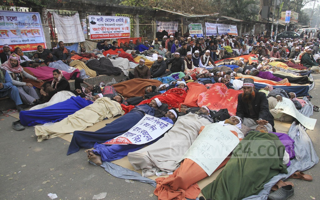 Ebtedayee madrasa teachers are on a hunger strike for a second day on Wednesday in front of the National Press Club after staying there on a sit-in protest since Jan 1 demanding to nationalise their education institutions across the country. Photo: Abdullah Al Momin
