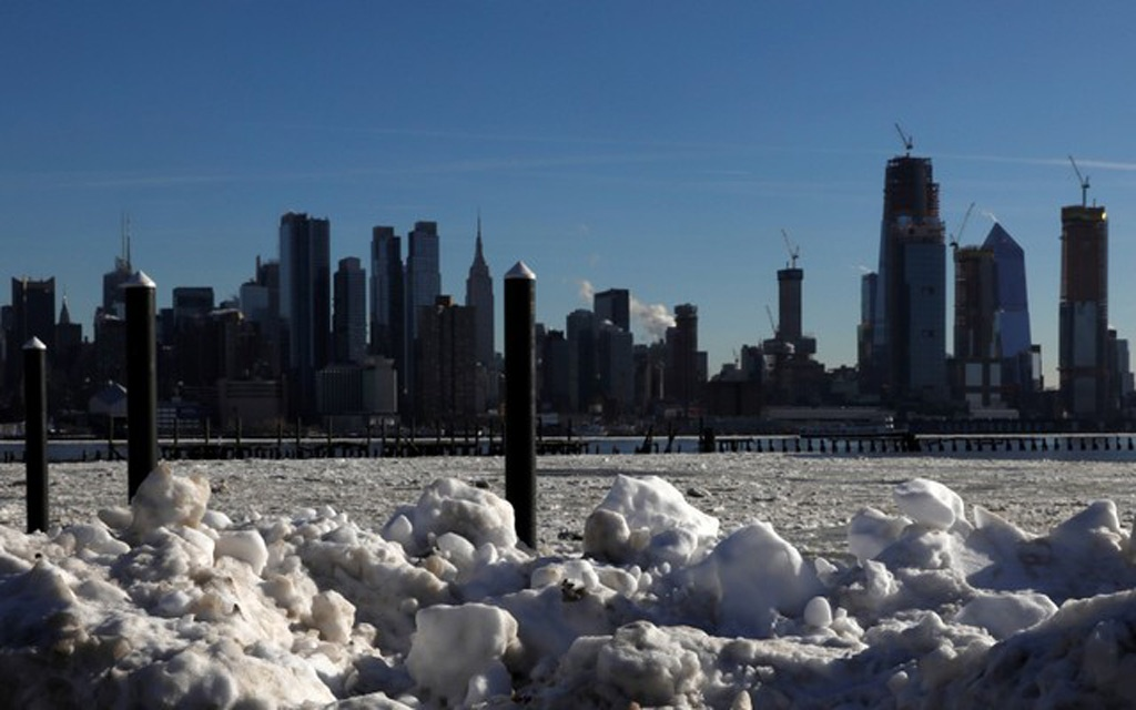 Ice is seen on the Hudson River between New Jersey and New York City, as seen from Weehawken, New Jersey, U.S., January 7, 2018. Reuters