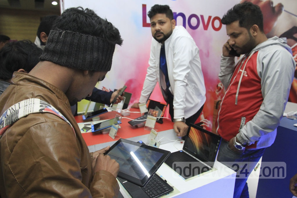 Visitors check out devices at the 'Smartphone and Tab Expo 2018' at the Bangabandhu International Conference Centre on Thursday. Photo: Abdullah Al Momin