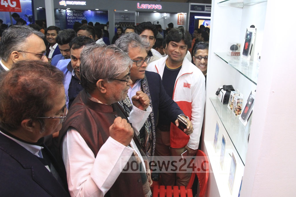 Posts, Telecommunications and IT Minister Mustafa Jabbar and State Minister Zunaid Ahmed Palak go around stalls after inauguration of the three-day-long 'Smartphone and Tab Expo 2018' on Thursday. Photo: Abdullah Al Momin