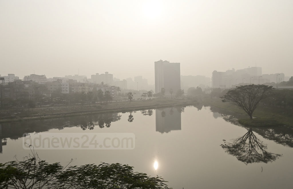 Fog blankets the afternoon in Dhaka on Thursday. The temperature is rising after days of cold snap, but Thursday's wind made it the most chilling day in weeks. The photo is taken from Karwan Bazar.