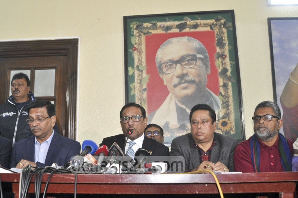 Awami League General Secretary Obaidul Quader addressing a press conference at the party president's Dhanmondi offices on Saturday evening.
