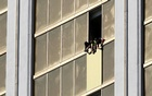 Workers board up a broken window at the Mandalay Bay hotel, where shooter Stephen Paddock conducted his mass shooting along the Las Vegas Strip, in Las Vegas, Nevada, US, Oct 6, 2017. Reuters