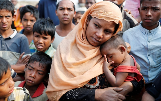 Samjida, the wife of Momtaz Ullah, reacts outside a hospital after her husband was killed at Kutupalong Rohingya refugee camp, near Cox's Bazar, Bangladesh Jan 13, 2018. Reuters