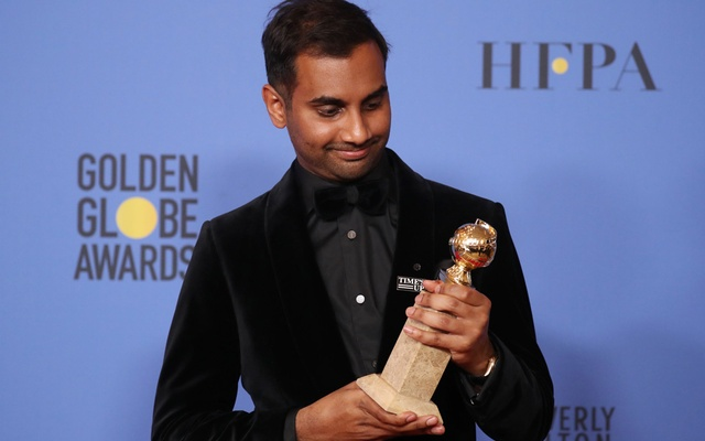 Aziz Ansari poses with the Golden Globe award for Best Performance by an Actor in a Television Series - Musical or Comedy for