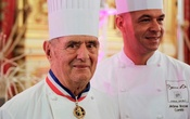 FILE PHOTO: Famous French chef Paul Bocuse (L), poses with his son Jerome at the town hall in Lyon, France, January 25, 2011. Paul Bocuse has died, January 20, 2018, aged 91. Picture taken January 25, 2011. Reuters