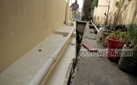 Ledges of two buildings came to contact after one of those tilts at Jagannath Saha Road in Dhaka's Lalbagh on Sunday. Photo: Abdullah Al Momin