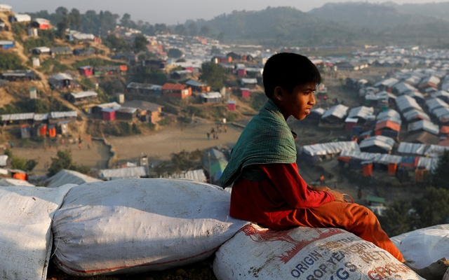 A Rohingya refugee child looks at the vill from a hill at Unchiparang refugee camp, near Cox's Bazar, Bangladesh Jan 11, 2018. Reuters