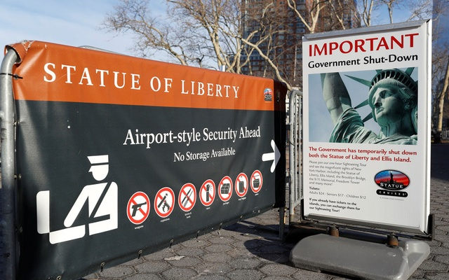 A sign announcing the closure of the Statue of Liberty, due to the US government shutdown, sits near the ferry dock to the Statue of Liberty at Battery Park in Manhattan, New York, US, Jan 20, 2018. Reuters