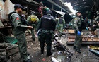 Military personnel and police officers inspect the site of a bomb attack at a market in the southern province of Yala, Thailand, Jan 22, 2018. Reuters