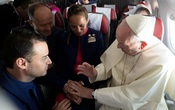 Pope Francis celebrates the marriage of crew members Paula Podest (centre) and Carlos Ciufffardi (left) during the flight between Santiago and the northern city of Iquique, Chile, Jan 18, 2018. Osservatore Romano/Handout via Reuters