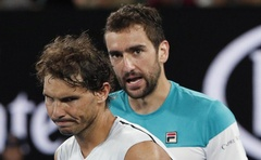 Tennis - Australian Open - Quarterfinals - Rod Laver Arena, Melbourne, Australia, January 23, 2018. Spain's Rafael Nadal and Croatia's Marin Cilic after Rafael Nadal retires from the match due to injury. REUTERS/Edgar Su