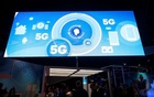 File Photo - A video promotes the 5G mobile wireless standard at the Qualcomm booth during the 2017 CES in Las Vegas, Nevada Jan 6, 2017. Reuters