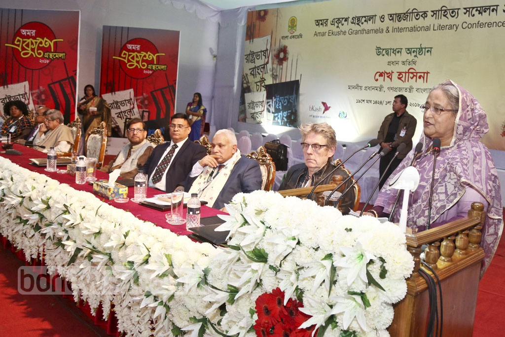 Prime Minister Sheikh Hasina addressing the launch of the Amar Ekushey Book Fair and International Literary Conference at Dhaka's Bangla Academy premises on Thursday.