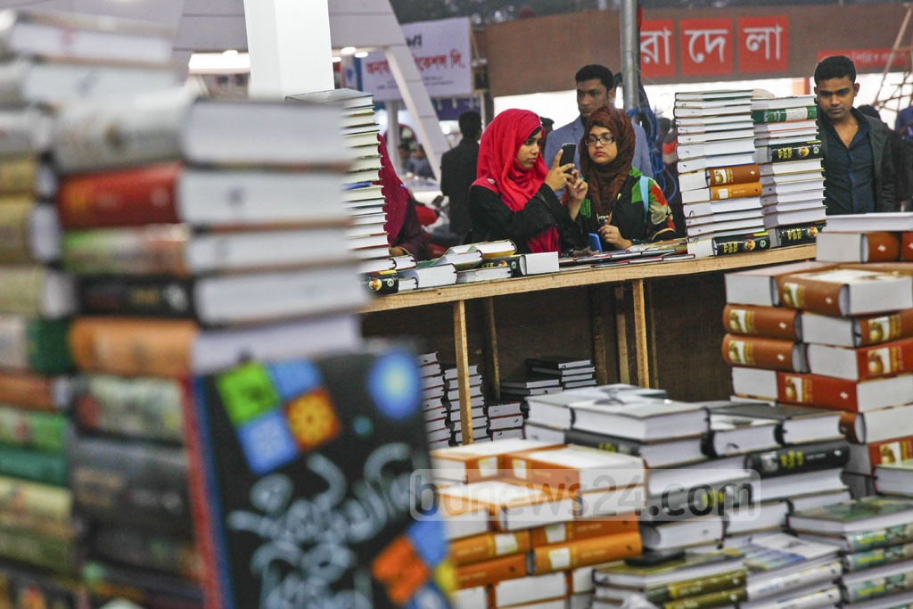 Visitors browsing books in stalls on the first day of the Amar Ekushey Book Fair, one of the most important events in the literary calendar in Bangladesh.