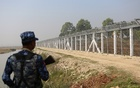 A Myanmar policeman stands outside of a camp set up by Myanmar's Social Welfare, Relief and Resettlement Minister to prepare for the repatriation of displaced Rohingyas, who fled to Bangladesh, outside Maungdaw in the state of Rakhine, Myanmar Jan 24, 2018. Reuters