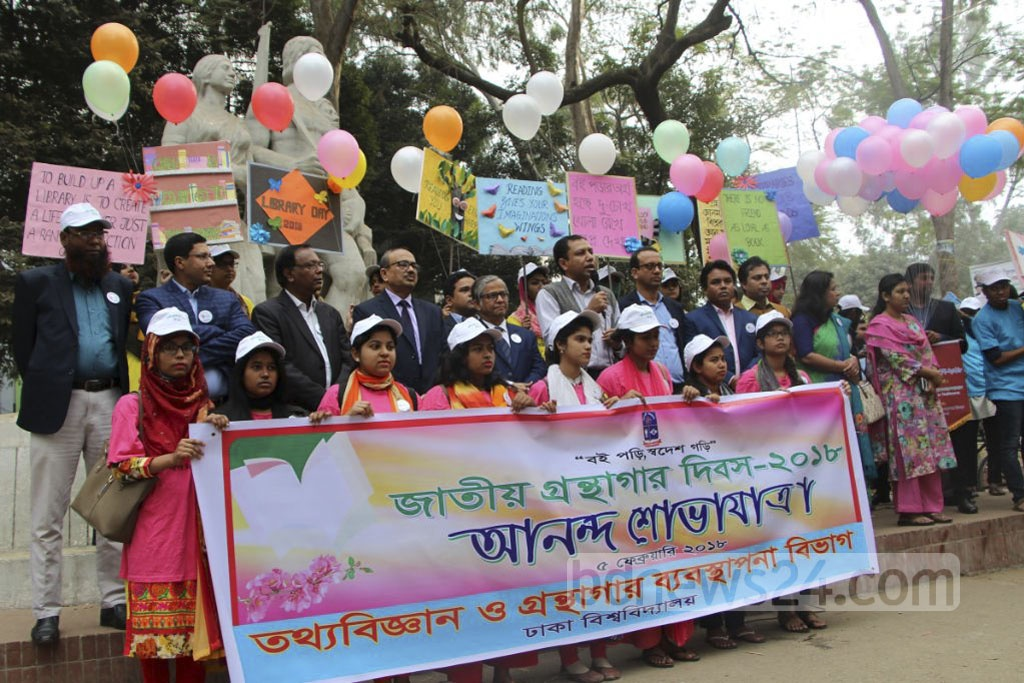 The authorities take out a procession on the Dhaka University campus to mark National Library Day on Monday.