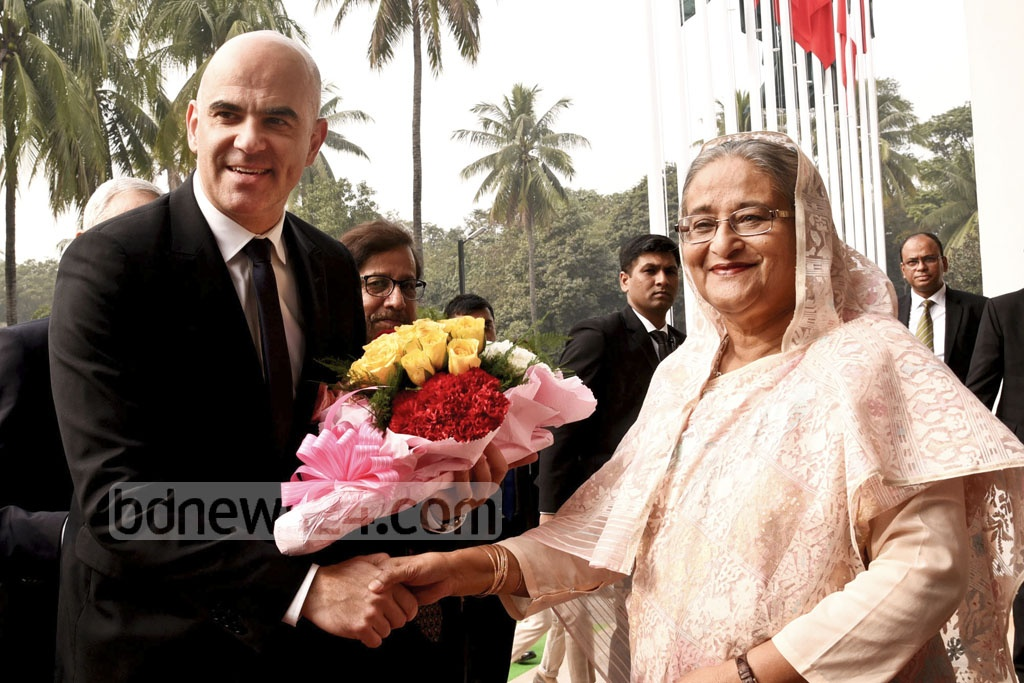 Prime Minister Sheikh Hasina welcomes visiting Switzerland President Alain Berset to her office on Monday.