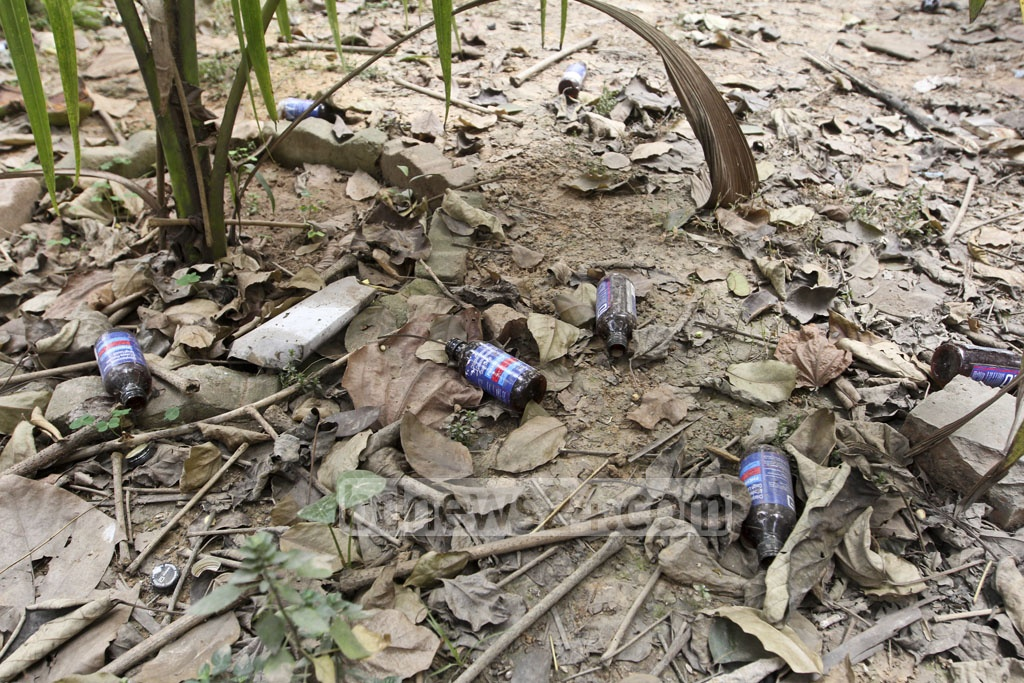 Empty bottles of contraband cough syrup Phensedyl seen at the Curzon Hall of the Dhaka University campus. Photo taken on Tuesday. The Indian syrup is much in demand with addicts in Bangladesh as its Codeine content is unusually high that give consumers a fix. Photo: Abdullah Al Momin