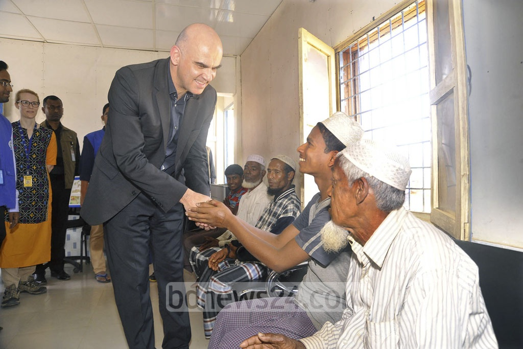 Swiss President Alain Berset ​is being received by Foreign Minister AH Mahmud Ali and Cultural Affairs Minister Asaduzzaman Noor at Cox's Bazar airport ​​​on his arrival to visit Rohingya refugee ​camp on Tuesday.