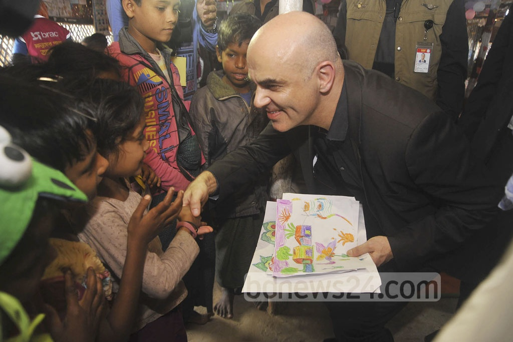 Swiss President Alain Berset ​brings some joy to the children of Kutupalong​​ Rohingya refugee camp ​in Cox's Bazar during his visit ​on Tuesday.