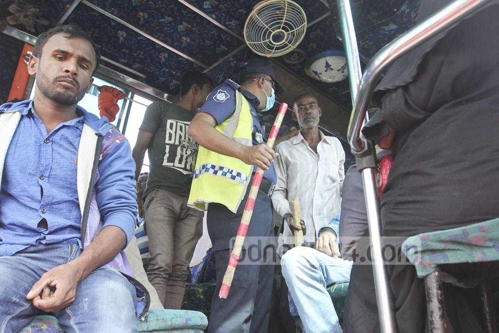 Police search a bus in Kachpur area of the city on Wednesday as security tightened ahead of the verdict of a graft case against BNP chairperson Khaleda Zia. Photo: Abdullah Al Momin