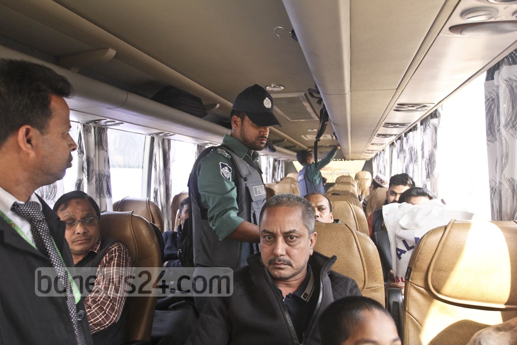 Police search a bus in Signboard area of the city on Wednesday as security tightened ahead of the verdict of a graft case against BNP chairperson Khaleda Zia. Photo: Abdullah Al Momin