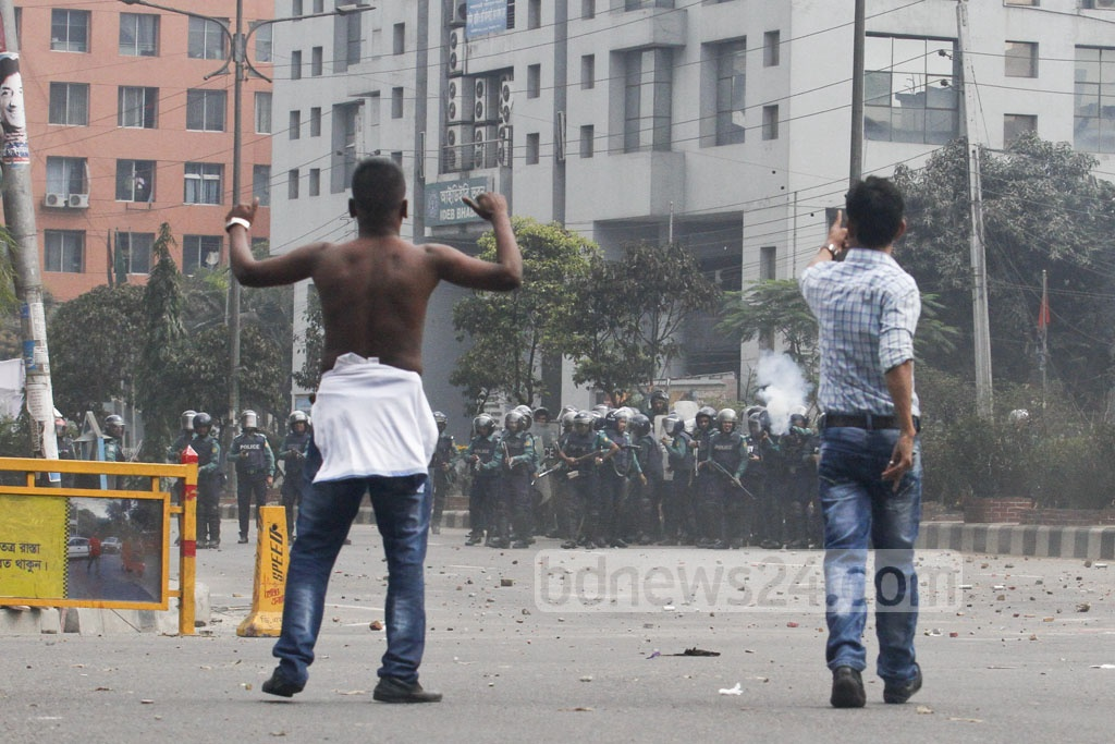 BNP activists clash with police near Kakrail Church area in the capital on Thursday when their party chief Khaleda Zia was heading towards the special tribunal that handed down a five-year prison sentence for embezzling the Zia Orphanage Trust fund. Photo: asif mahmud ove