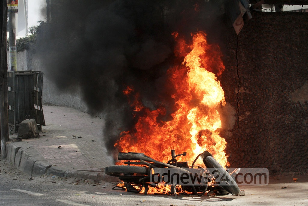 A motorcycle is set on fire during a clash between BNP activists and police near Kakrail Church area in the capital on Thursday when their party chief Khaleda Zia was heading towards the special court that handed down a five-year prison sentence for embezzling the Zia Orphanage Trust fund. Photo: asif mahmud ove