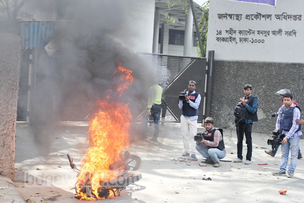 A motorcycle is set on fire during a clash between BNP activists and police clash with police near Kakrail Church area in the capital on Thursday when their party chief Khaleda Zia was heading towards the special tribunal that handed down a five-year prison sentence for embezzling the Zia Orphanage Trust fund. Photo: asif mahmud ove