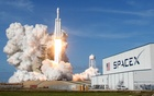 A SpaceX Falcon Heavy rocket lifts off from historic launch pad 39-A at the Kennedy Space Center in Cape Canaveral, Florida, US, February 6, 2018. Reuters