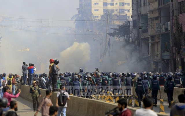 Police lob tear gas canisters during a clash with BNP activists at Nazimuddin road in the capital on Thursday when their party chief Khaleda Zia was heading towards the special tribunal that handed down a five-year prison sentence for embezzling the Zia Orphanage Trust fund.