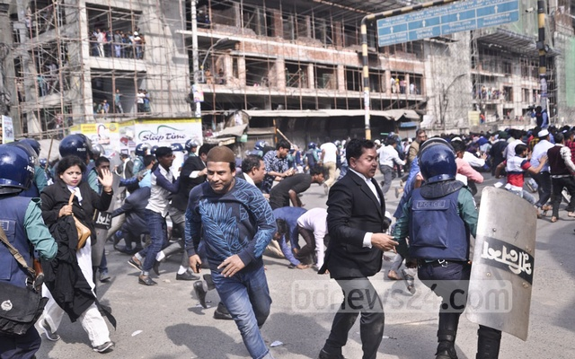 BNP activists clash with police at Nazimuddin road in the capital on Thursday when their party chief Khaleda Zia was heading towards the special tribunal that handed down a five-year prison sentence for embezzling the Zia Orphanage Trust fund.