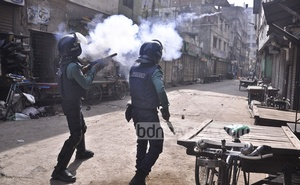Police lob tear gas canisters during a clash with BNP activists at Nazimuddin road in the capital on Thursday.
