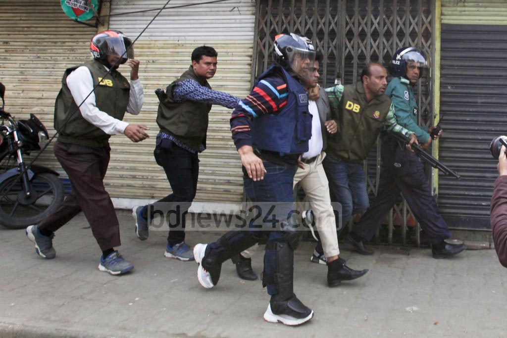 A number of BNP activists are detained during a clash with police at Nazimuddin road in the capital on Thursday when their party chief Khaleda Zia was heading towards the special tribunal that handed down a five-year prison sentence for embezzling the Zia Orphanage Trust fund.