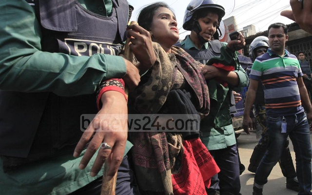 Police arrest a woman during a clash with BNP activists at Nazimuddin road in the capital on Thursday when their party chief Khaleda Zia was heading towards the special tribunal that handed down a five-year prison sentence for embezzling the Zia Orphanage Trust fund.