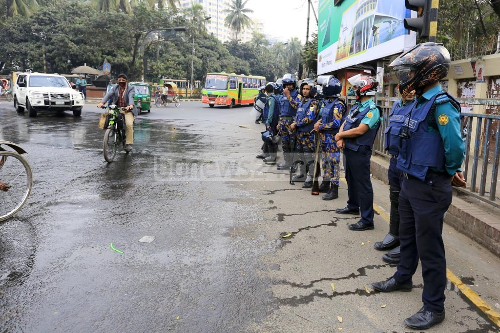 A contingent of police has been deployed at Kadam Fountain point near the Supreme Court on Thursday as the capital comes under a security blanket over the verdict of Zia Orphanage Trust graft case against BNP chief Khaleda Zia. Photo: mostafigur rahman
